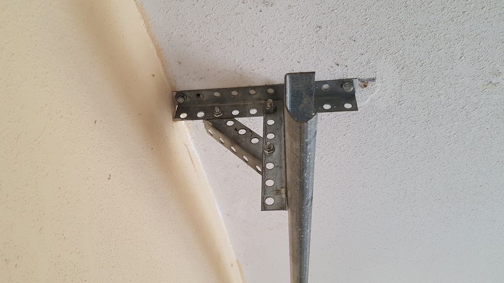 Properly Mounted Back-hanging of the track support hangers (punched angle holding tight against ceiling)