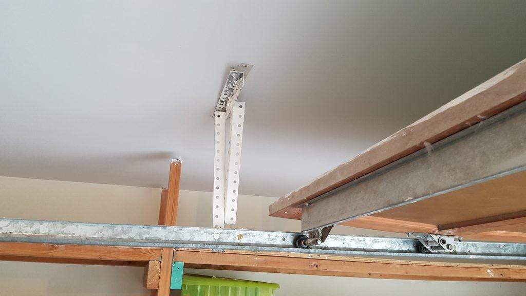 Garage door requiring backhang reenforcement