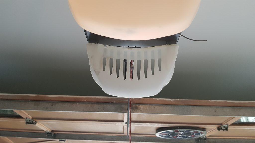 Alignment of garage door motor hanging from the ceiling