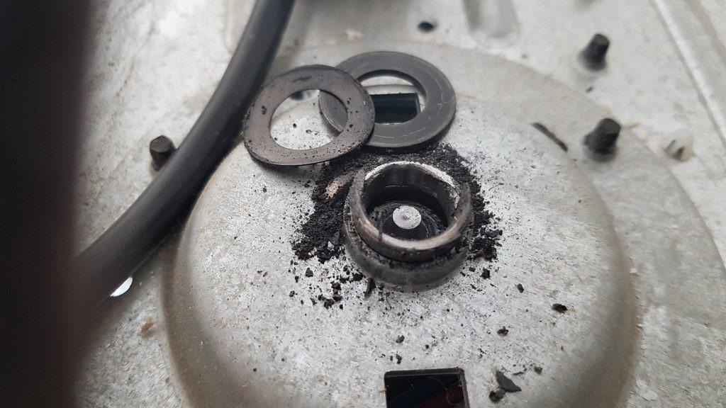 View of a garage door drive sproket stem that has broken off. This needs to be replaced.