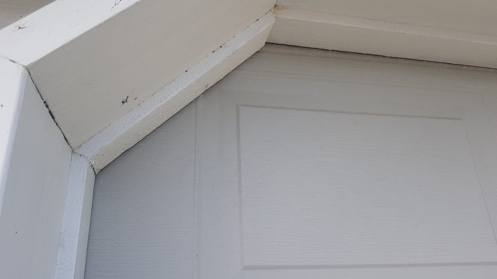 View of garage door before weather stripping has been applied.