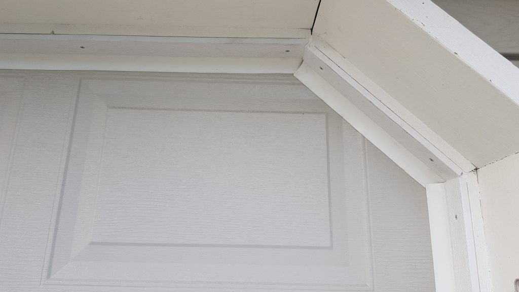 view of weather stripping that has been added to the right side of the door.