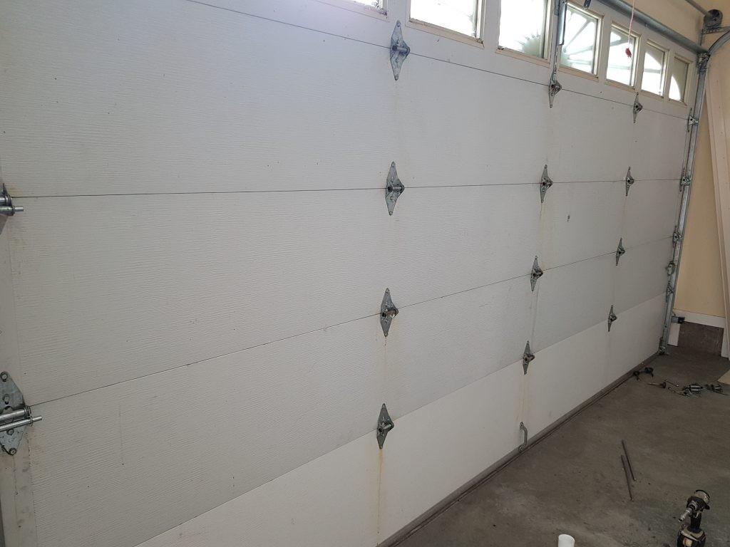 View of garage door that has fresh hinges applied