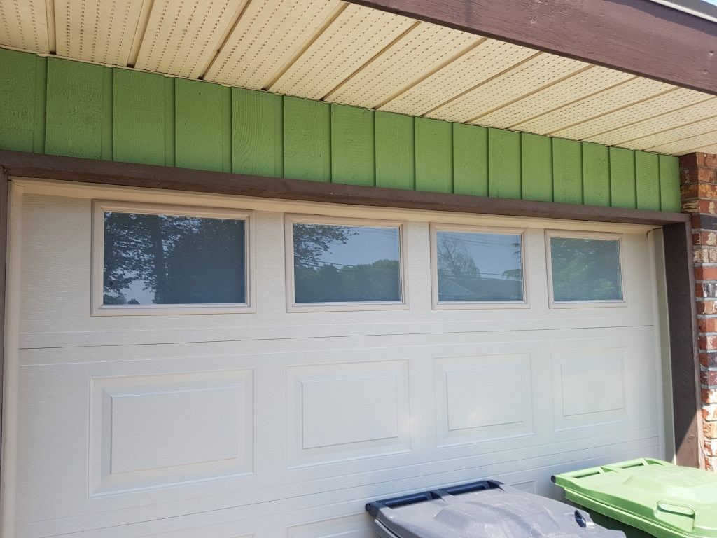 View of garage door that does not have the window inserts installed.
