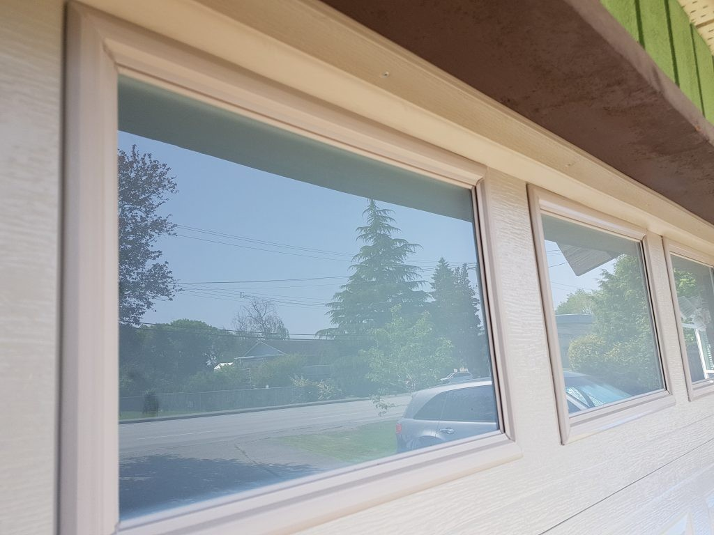 View of garage door that has no inserts installed on the window section.