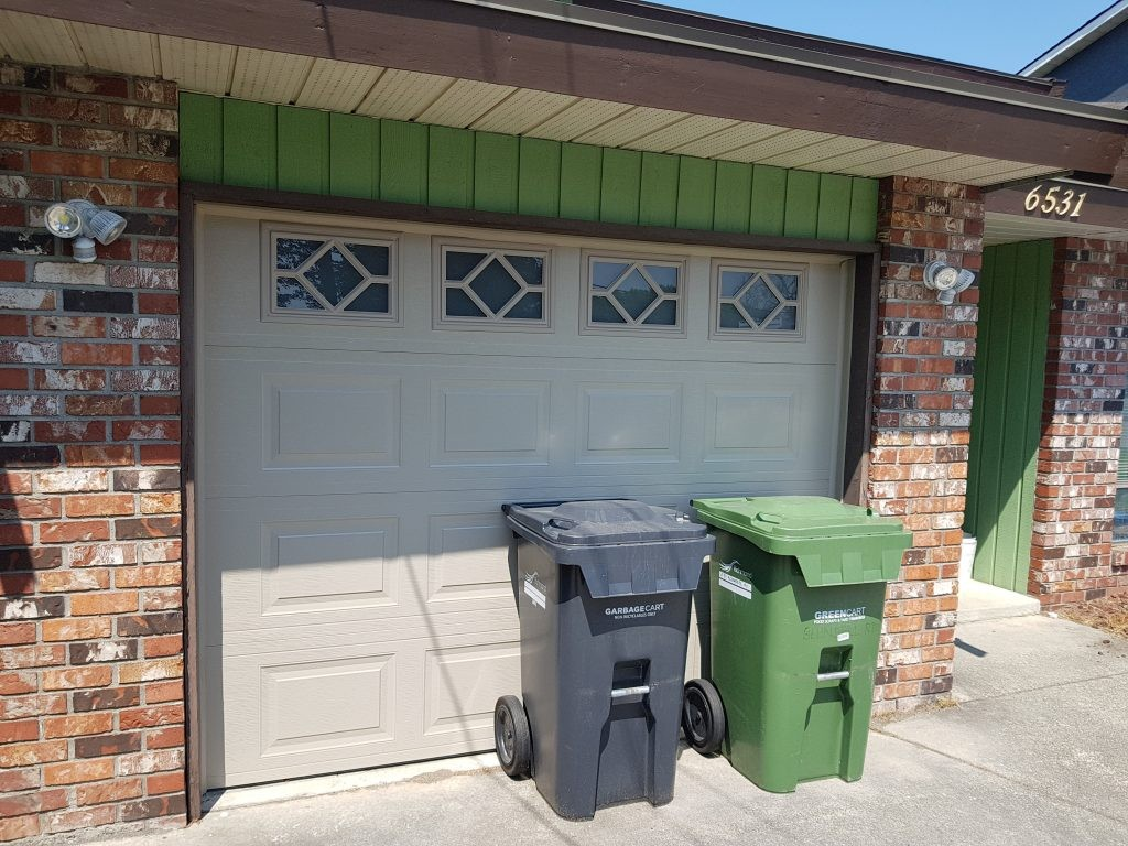 View of garage door that has been installed with insert. This door is in a Sandstone finish.