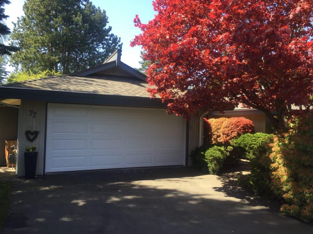 View of garage door that has been replaced with a insulated steel garage door