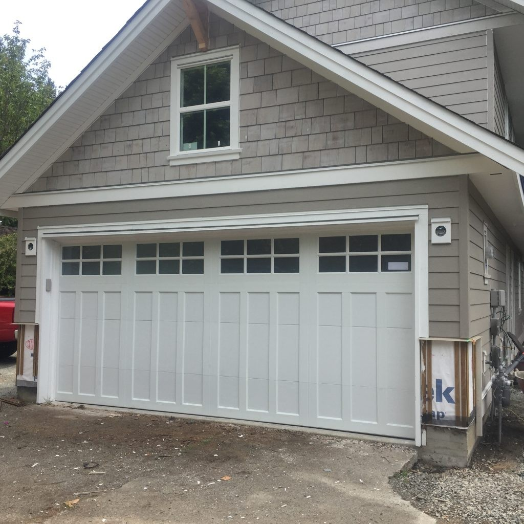 View of a double car garage door that has been installed with satin etch windows.