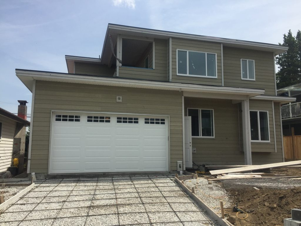 view of garage door that has been installed with long panels and stockton windowed top section in Burnaby