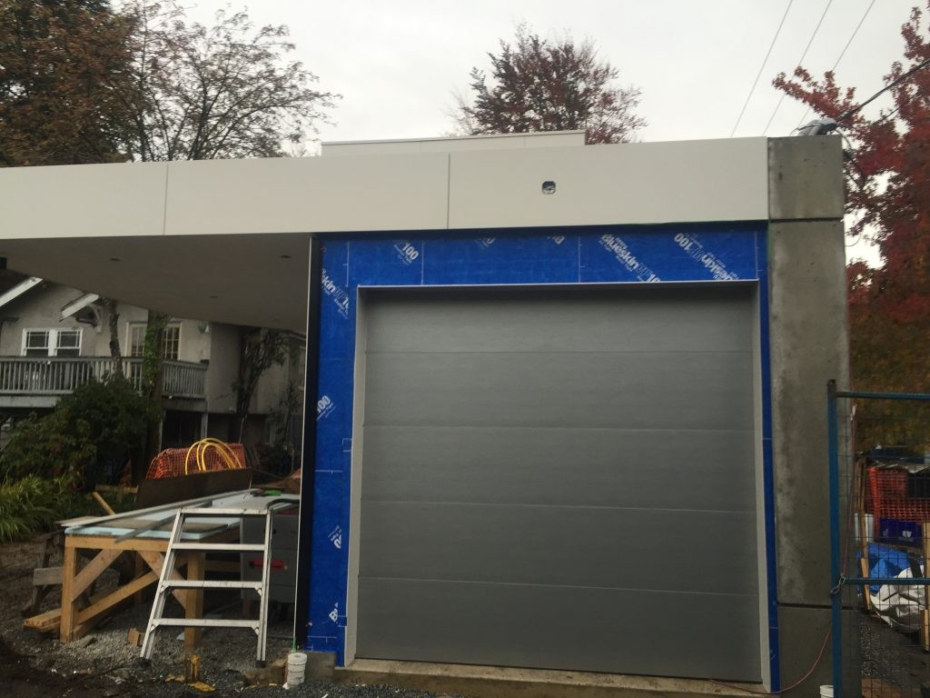 View of completed garage door installation of modern tech flush nickle