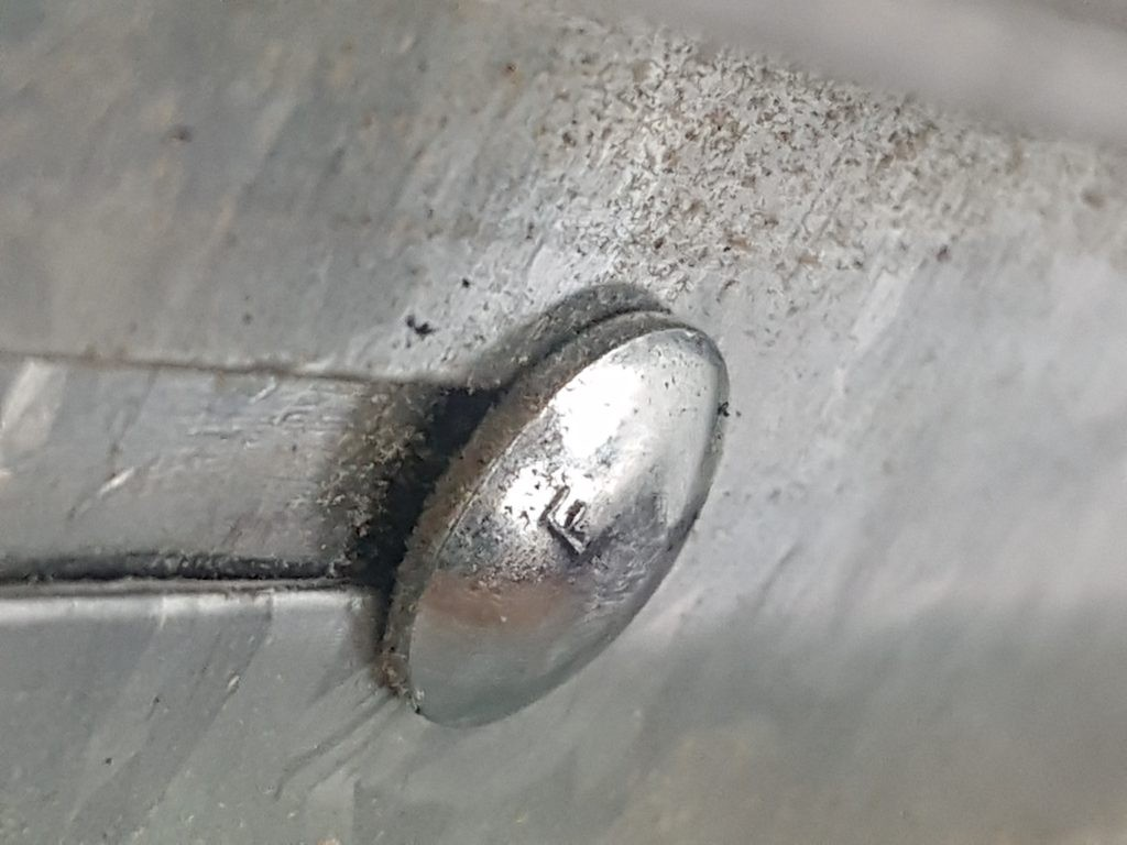 View of the track bolt that has been tightened.