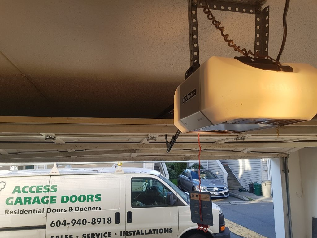 View of belt drive operator made by LiftMaster has just been installed in replacement of the old generation garage door motor.