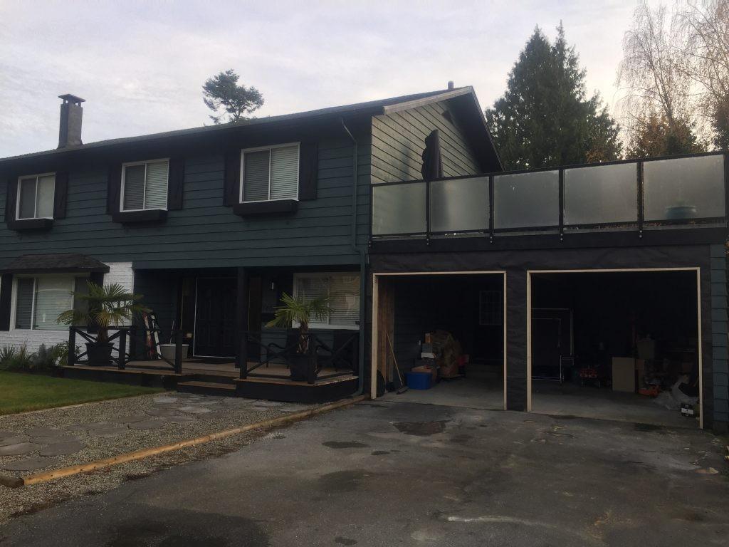 view of two garage door openings that have no garage doors installed yet.