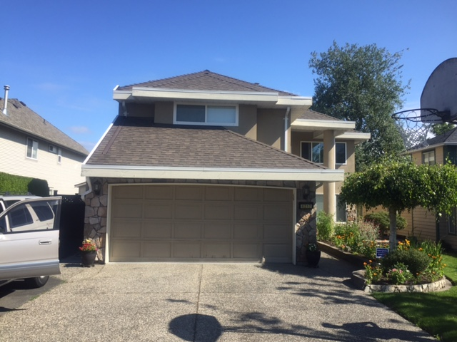 Before view of new garage door installed in Ladner