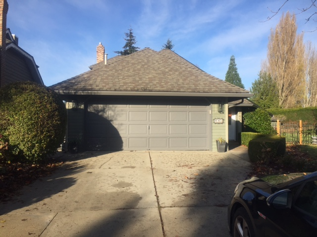 Before view of garage door installed in Tsawwassen.