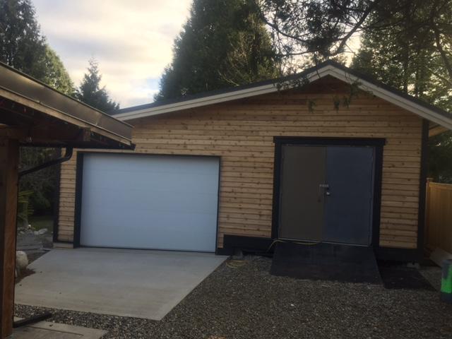 View of black flush Amarr door installed in Aldergrove